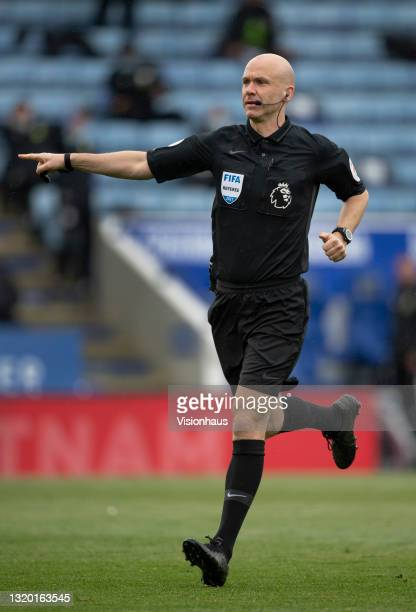 Referee Anthony Taylor points to the penalty spot during the Premier League match between Leicester City and Tottenham Hotspur at The King Power...