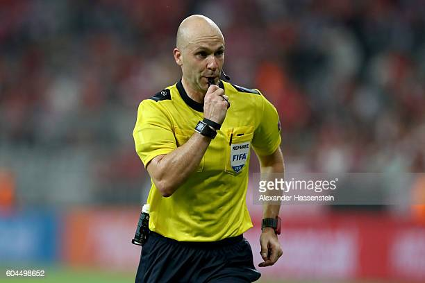 Referee Anthony Taylor reacts during the UEFA Champions League Group D match between FC Bayern Muenchen and FC Rostov at Allianz Arena on September...