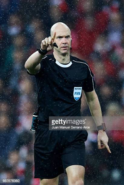Referee Anthony Taylor reacts during UEFA Europa League Round of 16 match between Athletic Club Bilbao and Olympique Marseille at the San Mames...