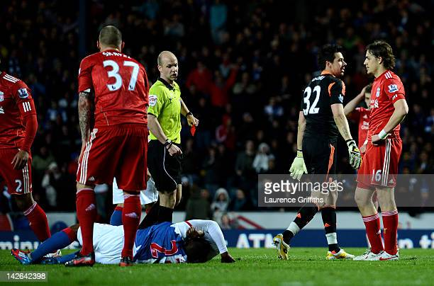 Referee Anthony Taylor sends off Alexander Doni of Liverpool after fouling Junior Hoilett of Blackburn Rovers to concede a penalty during the...