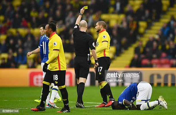 Referee Anthony Taylor shows a yellow card to Adlene Guedioura of Watford during the Premier League match between Watford and Everton at Vicarage...