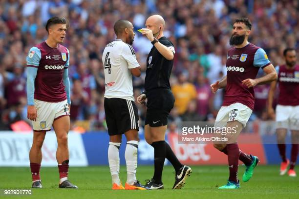 Referee Anthony Taylor shows Denis Odoi of Fulham his 1st yellow card during the Sky Bet Championship Play Off Final between Aston Villa and Fulham...