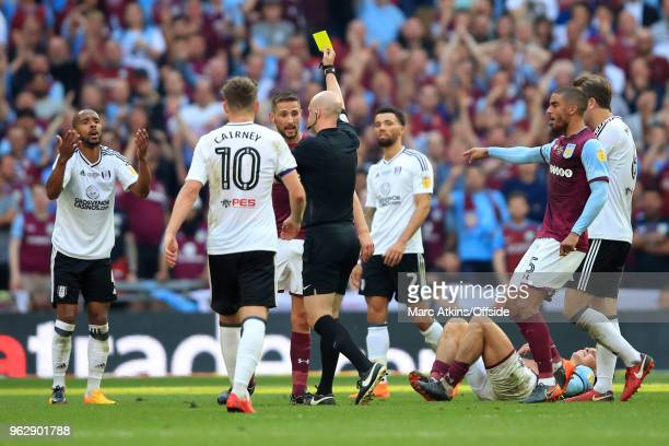 Referee Anthony Taylor shows Denis Odoi of Fulham his 2nd yellow card during the Sky Bet Championship Play Off Final between Aston Villa and Fulham...
