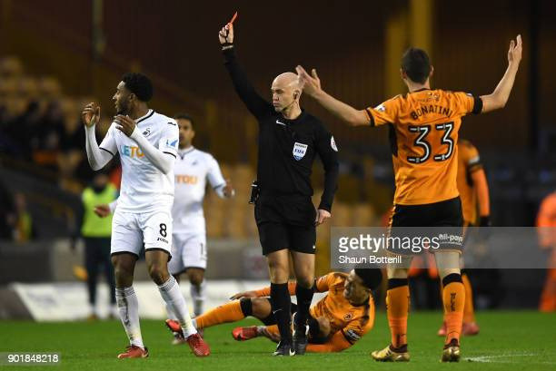 Referee Anthony Taylor shows Leroy Fer of Swansea City a red card during The Emirates FA Cup Third Round match between Wolverhampton Wanderers and...