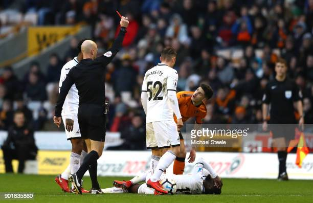 Referee Anthony Taylor shows Ruben Vinagre of Wolverhampton Wanders a red card during The Emirates FA Cup Third Round match between Wolverhampton...