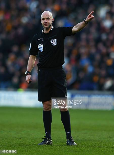 Referee Anthony Taylor signals during the Barclays Premier League match between Hull City and Queens Park Rangers at KC Stadium on February 21 2015...