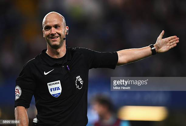 Referee Anthony Taylor signals during the Premier League match between Chelsea and West Ham United at Stamford Bridge on August 15 2016 in London...