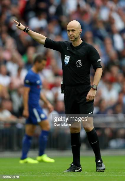 Referee Anthony Taylor signals during the Premier League match between Tottenham Hotspur and Chelsea at Wembley Stadium on August 20 2017 in London...