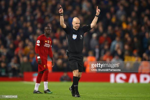 Referee Anthony Taylor signals for VAR during the Premier League match between Liverpool FC and Wolverhampton Wanderers at Anfield on December 29,...