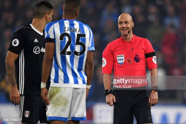 Referee Anthony Taylor smiles during the English Premier League football match between Huddersfield Town and Fulham at the John Smith's stadium in...