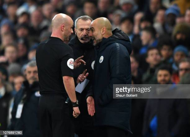 Referee Anthony Taylor speaks to Josep Guardiola Manager of Manchester City during the Premier League match between Manchester City and Liverpool FC...