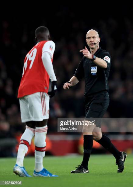 Referee Anthony Taylor speaks with Nicolas Pepe of Arsenal during the FA Cup Third Round match between Arsenal and Leeds United at Emirates Stadium...