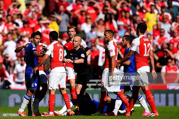 Referee Anthony Taylor splits up Radamel Falcao Garcia of Chelsea and Mikel Arteta of Arsenal during the FA Community Shield match between Chelsea...