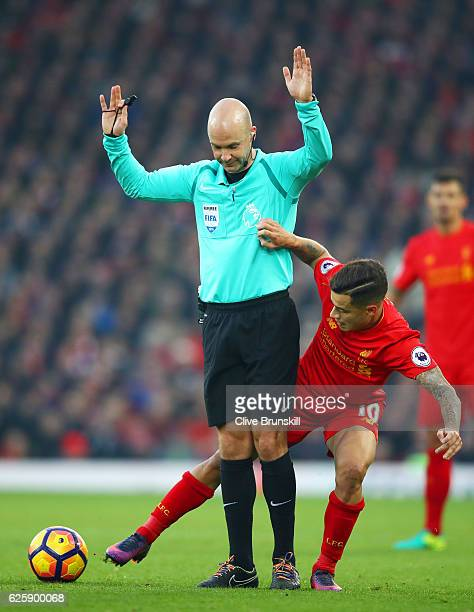 Referee Anthony Taylor stands on the way of Philippe Coutinho of Liverpool during the Premier League match between Liverpool and Sunderland at...