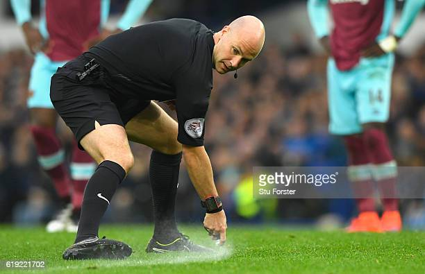 Referee Anthony Taylor uses his vanishing spray during the Premier League match between Everton and West Ham United at Goodison Park on October 30...