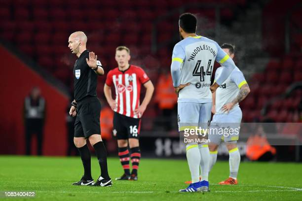 Referee Anthony Taylor waits for the VAR decision on Craig Brysons's goal during the FA Cup Third Round Replay match between Southampton FC and Derby...