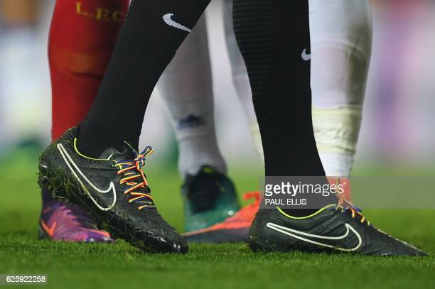 Referee Anthony Taylor wears rainbow laces in support of lesbian gay bisexual and transgender players and fans during the English Premier League...