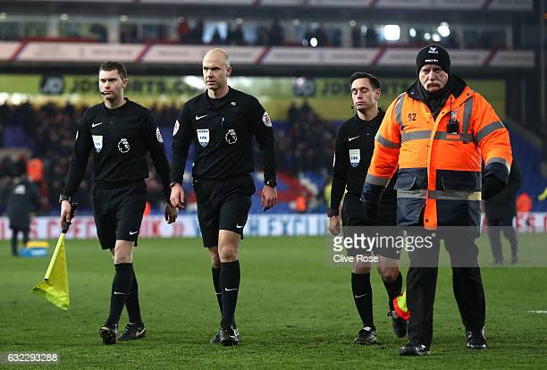 Referee Anthony TaylorGary Beswick assistant and Steve Bennett walk off the pitch during the Premier League match between Crystal Palace and Everton...