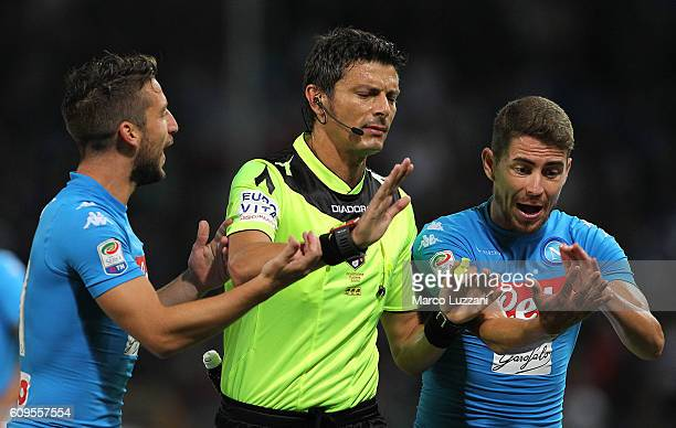 Referee Antonio Damato disputes wit Jorge Luiz Frello Jorginho and Dries Mertens of SSC Napoli during the Serie A match between Genoa CFC and SSC...