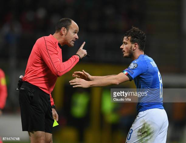 Referee Antonio Mateu Lahoz and Alessandro Florenzi of Italy of Italy chat at the end of the FIFA 2018 World Cup Qualifier PlayOff Second Leg between...
