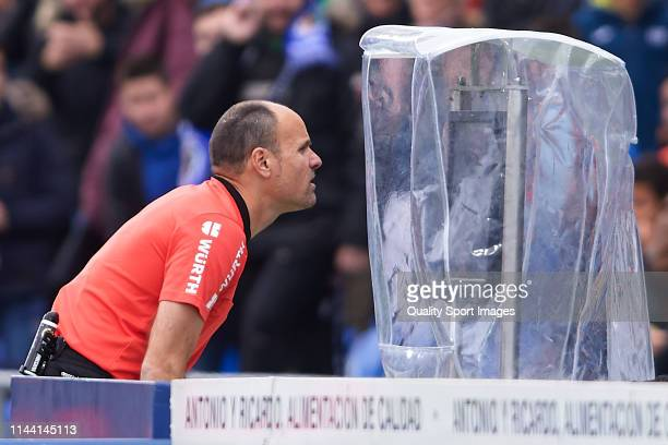 Referee Antonio Mateu Lahoz consulting the VAR during the La Liga match between Getafe CF and Sevilla FC at Coliseum Alfonso Perez on April 21 2019...