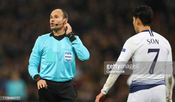 Referee Antonio Mateu Lahoz gestures as VAR is checked during the UEFA Champions League Round of 16 First Leg match between Tottenham Hotspur and...