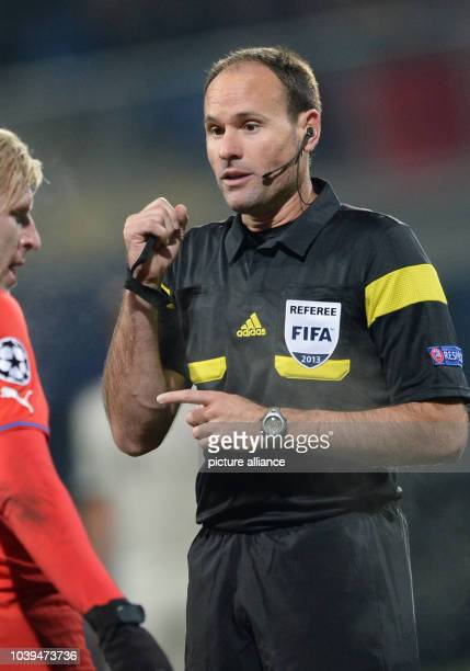 Referee Antonio Mateu Lahoz gestures during the UEFA Champions League Group D soccer match between FC Viktoria Plzen and FC Bayern Munich at...