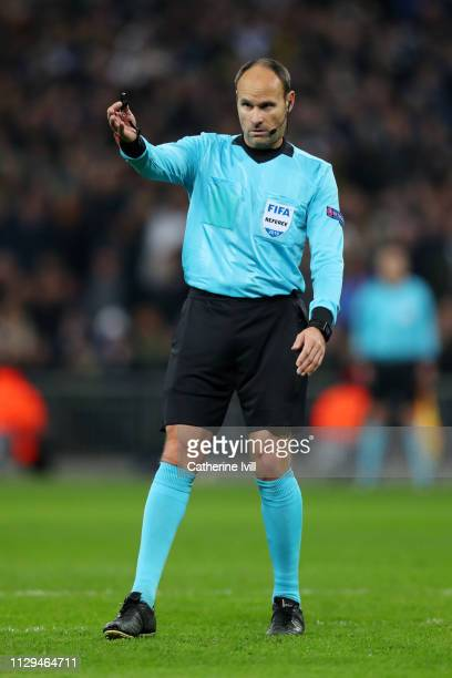 Referee Antonio Mateu Lahoz gestures during the UEFA Champions League Round of 16 First Leg match between Tottenham Hotspur and Borussia Dortmund at...