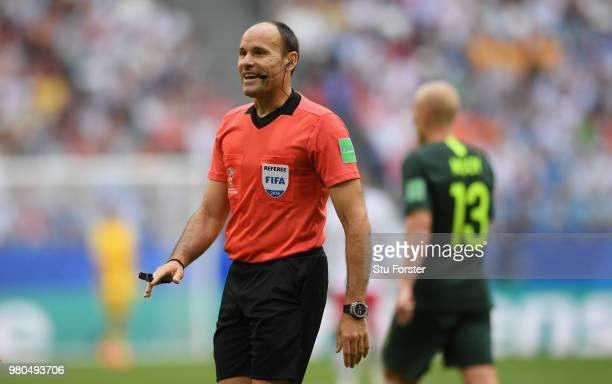 Referee Antonio Mateu Lahoz makes a point during the 2018 FIFA World Cup Russia group C match between Denmark and Australia at Samara Arena on June...