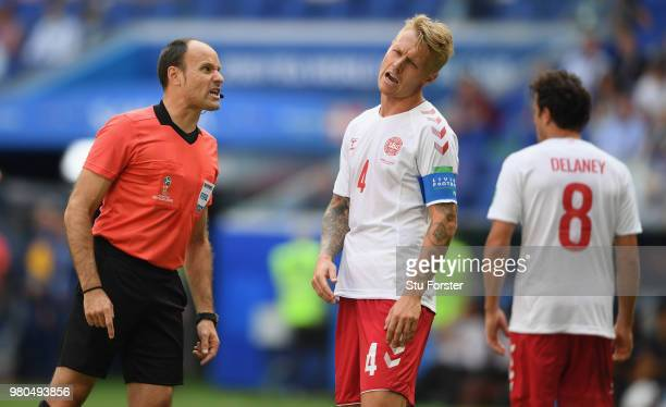Referee Antonio Mateu Lahoz makes a point to Denmark captain Simon Kjaer during the 2018 FIFA World Cup Russia group C match between Denmark and...