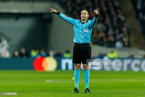 Referee Antonio Mateu Lahoz of Spain gestures during the UEFA Champions League Round of 16 First Leg match between Tottenham Hotspur and Borussia...