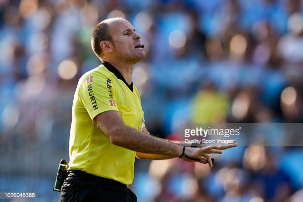 Referee Antonio Mateu Lahoz reacts during the La Liga match between RC Celta de Vigo and Club Atletico de Madrid at Abanca Balaidos Stadium on...