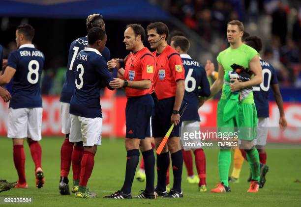 Referee Antonio Miguel Mateu Lahoz and France's Patrice Evra shake hands after the game