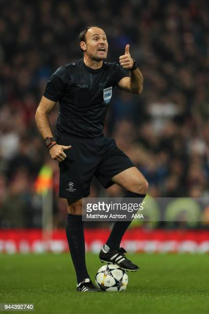 Referee Antonio Miguel Mateu Lahoz gestures during the UEFA Champions League Quarter Final Second Leg match at Etihad Stadium on April 10 2018 in...