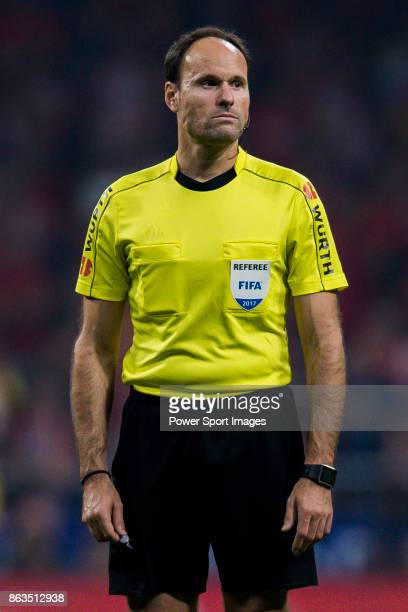 Referee Antonio Miguel Mateu Lahoz looks on during the La Liga 201718 match between Atletico de Madrid and FC Barcelona at Wanda Metropolitano on 14...