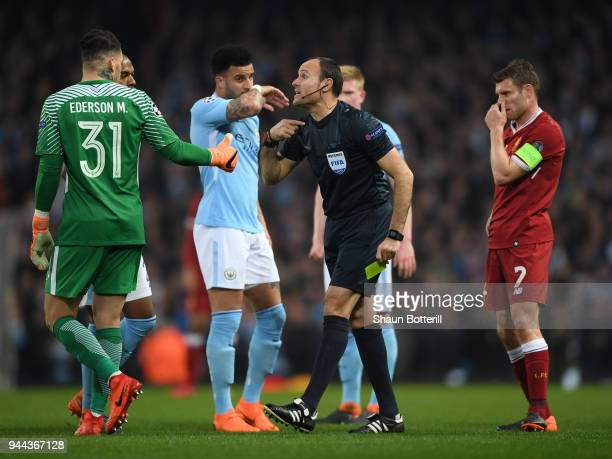 Referee Antonio Miguel Mateu Lahoz speaks to Ederson of Manchester City during the UEFA Champions League Quarter Final Second Leg match between...
