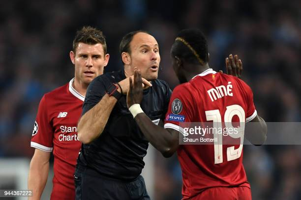 Referee Antonio Miguel Mateu Lahoz speaks to Sadio Mane of Liverpool during the UEFA Champions League Quarter Final Second Leg match between...