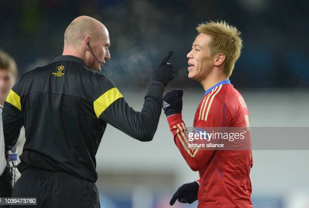 Referee Antony Gautier talks to Moscow's Keisuke Honda during the UEFA Champions League Group D soccer match between CSKA Moscow and FC Bayern Munich...