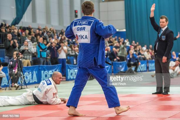 Referee Archie Shrimpton signals ippon while Daniel Powell of the West Midlands victoriously struts the mats following his 'knockout' throw of Danny...
