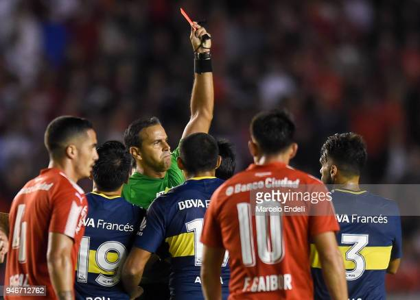 Referee Ariel Penel shows a red card to Pablo Perez of Boca Juniors during a match between Independiente and Boca Juniors as part of Superliga...