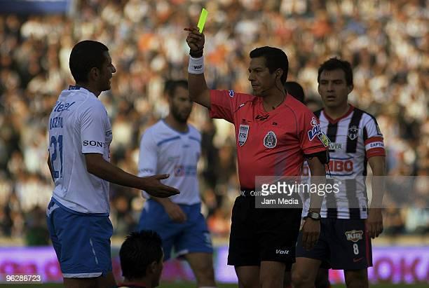 Referee Armando Archundia shows a yellow card to Jaime Lozano of Cruz Azul during a 2010 Bicentenario Mexican championship match between Monterrey...