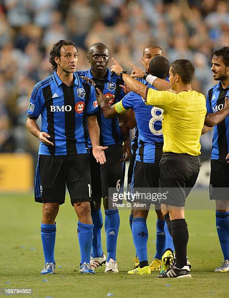 Referee Armando Villarreal points for defender Alessandro Nesta of the Montreal Impact to leave the field after receiving a red card during the...