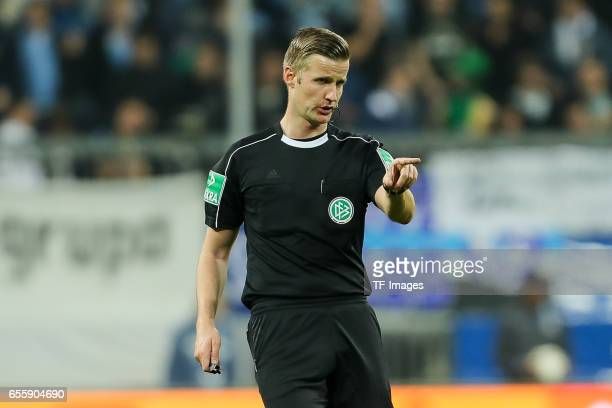 Referee Arne Aarnink gestures during the Second Bundesliga match between TSV 1860 Muenchen and FC Wuerzburger Kickers at Allianz Arena on March 17...