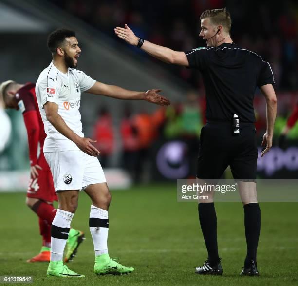 Referee Arne Aarnink gestures to Andrew Wooten of Sandhausen during the Second Bundesliga match between 1 FC Kaiserslautern and SV Sandhausen at...