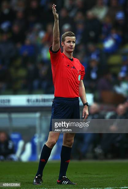 Referee Arne Aarnink reacts during the Second Bundesliga match between Karlsruher SC and Erzgebirge Aue at Wildpark Stadium on November 23 2014 in...