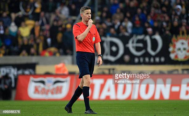 Referee Arne Aarnink reacts during the Third League match between SG Dynamo Dresden and Preussen Muenster at gluecksgas Arena on November 28 2015 in...