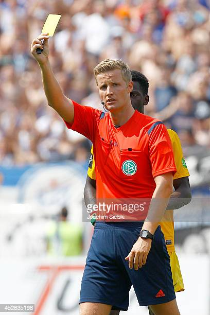 Referee Arne Aarnink show the yellow card during the Third League match between Preussen Muenster and Hansa Rostock at Preussenstadion on July 27...