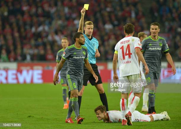 Referee Arne Aarnink shows a yellow card to Paulo Otavio of FC Ingolstadt during the Second Bundesliga match between 1 FC Koeln and FC Ingolstadt 04...