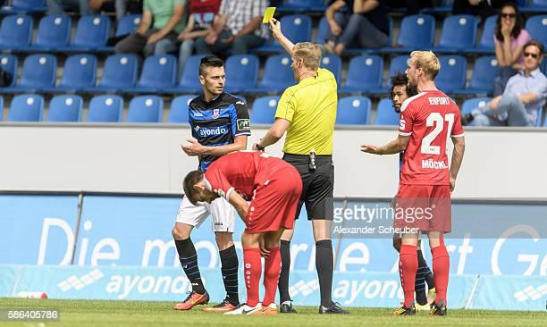 Referee Arne Aarnink shows Denis Streker of FSV Frankfurt during the Third League match between FSV Frankfurt and RW Erfurt at Volksbank Stadion on...