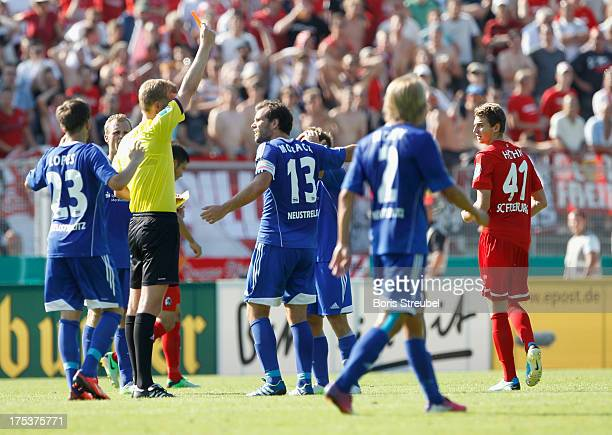 Referee Arne Aarnink shows the red card to Immanuel Hoehn of Freiburg during the DFB Cup first round match between TSG Neustrelitz and SC Freiburg at...